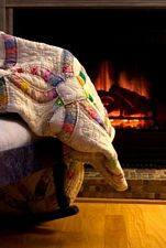 cozy quilt by fireplace