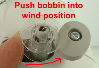 filling a bobbin with thread