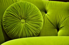 Green velvet  fabric couch and pillow