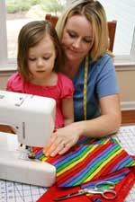 Child Learning To Sew